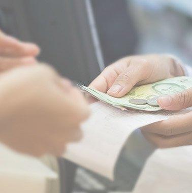 someone handing over cash