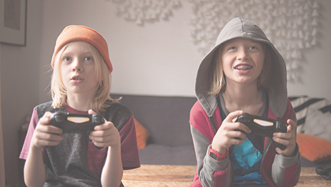 Two children play video games